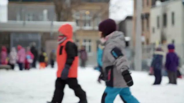 2 children walking on snow