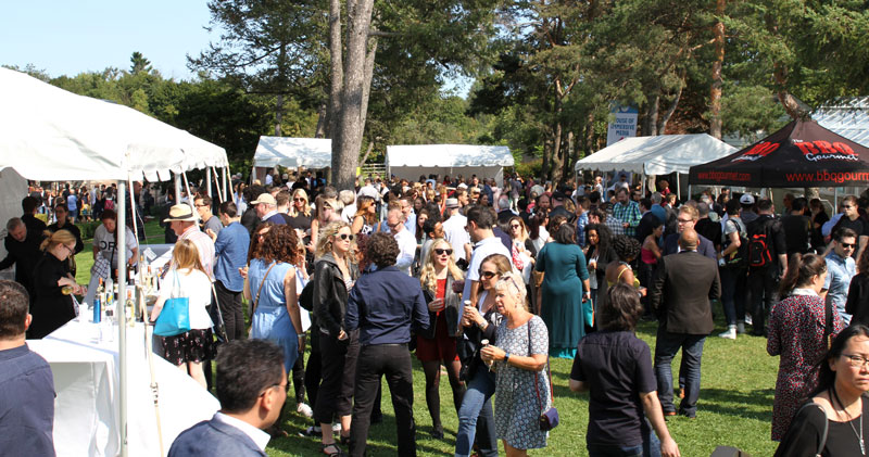 Crowd at a BBQ event with wine