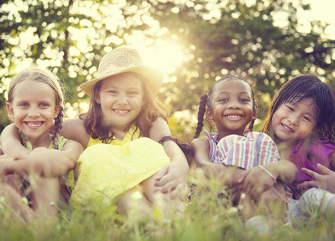 Four Children smiling in the grass