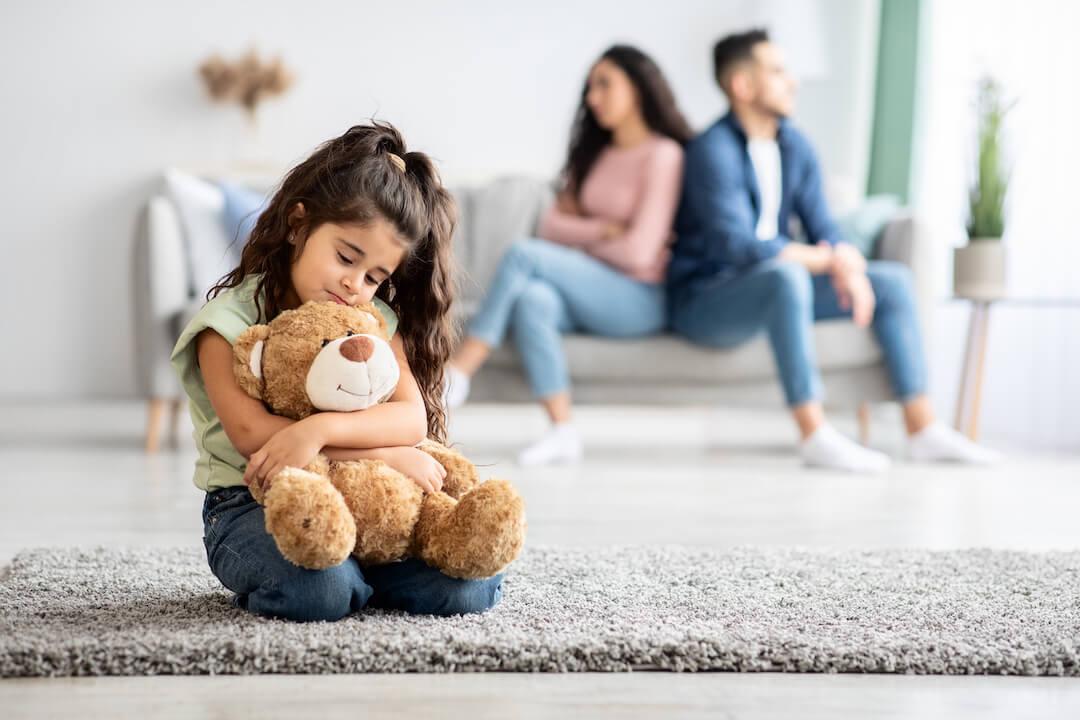 A little girl upset following the quarrel between her parents