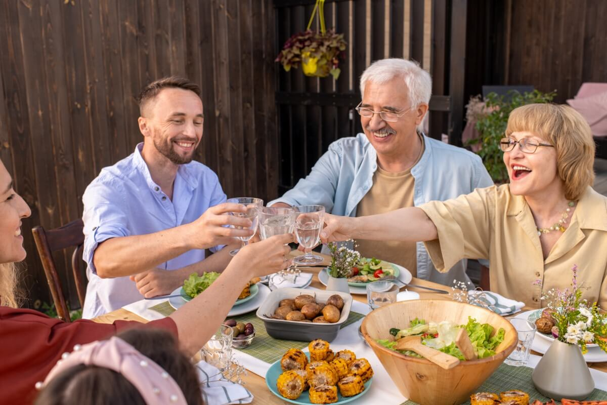 A family clinking glasses at a family celebration or birthday